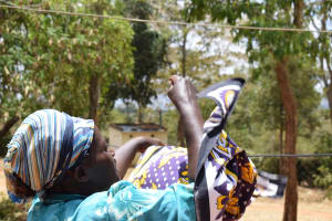 The Water Project: Mitini Community C -  Hanging Clothes To Dry