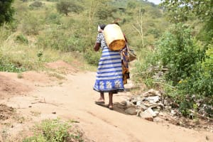 The Water Project: Kithumba Community C -  Carrying Water Home