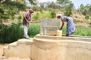 The Water Project: Kithumba Community C -  Using Community Well