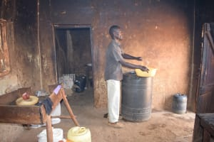 The Water Project: Ngaa Secondary School -  Collecting Water From Storage Tank