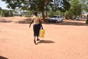 The Water Project: Kitooni Primary School -  Carrying Water