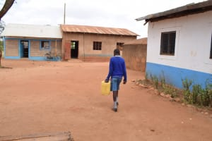 The Water Project: Muunguu Primary School -  Carrying Water