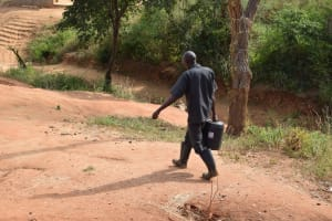 The Water Project: AIC Mbau Secondary School -  Carrying Water
