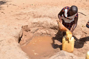 The Water Project: AIC Mbau Secondary School -  Fetching Water