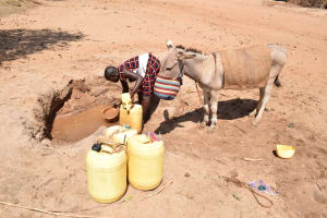 The Water Project: AIC Mbau Secondary School -  Filling Contianer With Water