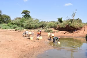 The Water Project: AIC Mbau Secondary School -  Filling Jerrican With Water