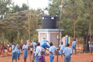 The Water Project:  Playing In Front Of Water Tank