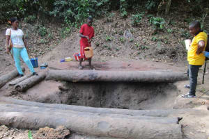 The Water Project: Mathem Community -  Collecting Water From Open Hole