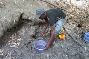 The Water Project: Mathem Community -  Filling Up Water From Scoop Hole
