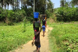 The Water Project: Roloko Community -  Carrying Water Home