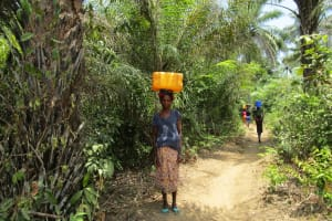 The Water Project: Roloko Community -  Carrying Water