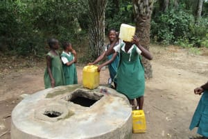 The Water Project: PC Bai Shebora Gbereh III Primary School -  Girls Gather Water At Open Well
