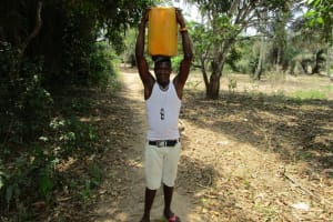 The Water Project: Mabendo Community, Mosque -  Carrying Water