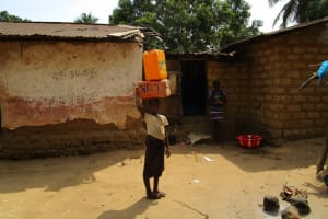 The Water Project: Mabendo Community -  Carrying Water
