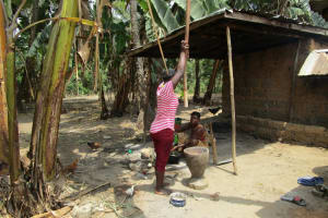 The Water Project: Mabendo Community -  Crushing Food For A Meal
