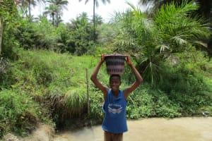 The Water Project: Komrabai Community, 35 Port Loko Road -  Boy Carrying Water