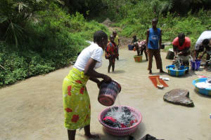 The Water Project: Komrabai Community, 35 Port Loko Road -  Washing Clothes And Bathing In Water Source