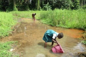 The Water Project: DEC Mathem Primary School -  Girl Fetching Water