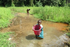 The Water Project: DEC Mathem Primary School -  Girl Hauls Fetched Water