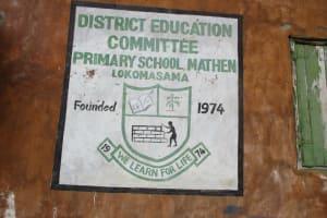 The Water Project: DEC Mathem Primary School -  School Logo