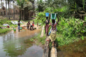 The Water Project: Mapitheri, Port Loko Road -  Carrying Water Home