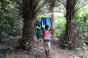 The Water Project: DEC Komrabai Primary School -  Carrying Water