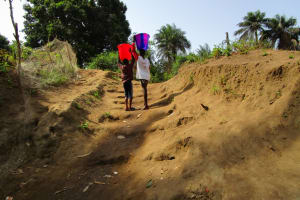 The Water Project: Tintafor Community, Shyllon Street -  Carrying Water Home