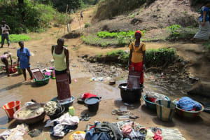 The Water Project: Tintafor Community, Shyllon Street -  Washing Clothes In Open Water Source