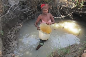 The Water Project: Mondor Community -  Lifting Water To Carry Home