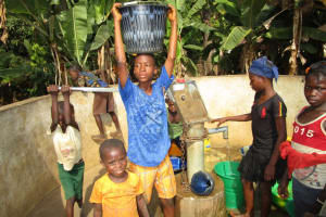 The Water Project: Pewullay Church of God Primary School -  Kids Carrying Water