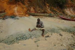 The Water Project: Pewullay Church of God Primary School -  Cleaning Fishing Net