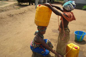 The Water Project: Kamasando DEC Primary School -  Preparing To Carry Water Home