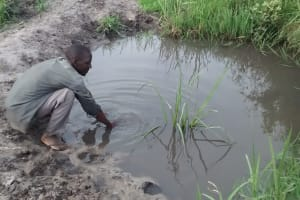 The Water Project: Kyamudikya Community -  Collecting Water From Open Source