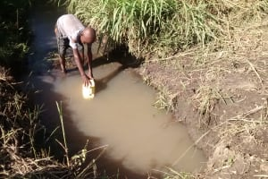 The Water Project: Alimugonza Community -  Filling Container With Water