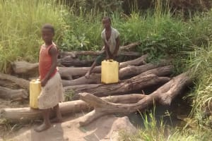 The Water Project: Alimugonza Community -  Kids Collecting Water