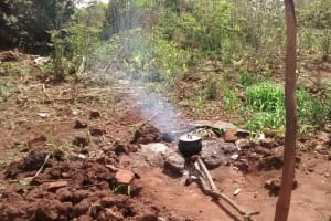 The Water Project: Hamis Water Source Pakanyi Community -  Food Cooks Outside