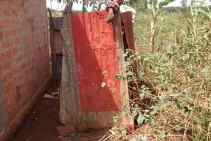 The Water Project: Hamis Water Source Pakanyi Community -  Latrine With Metal Siding