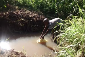The Water Project: Alimugonza Community A -  Filling Container With Water