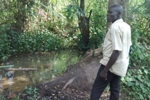 The Water Project: Nyakarongo Community -  The Open Water Source Used By The Community
