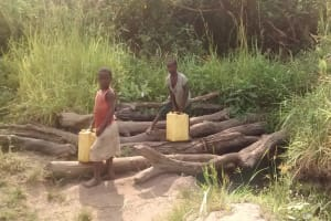 The Water Project: Alimugonza Community B -  Kids Collecting Water