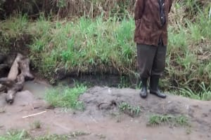 The Water Project: Alimugonza Community B -  Standing Near Open Water Source