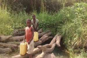 The Water Project: Alimugonza Pabidi Community -  Collecting Water