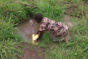 The Water Project: Kyamudikya Community A -  Filling Jerrican With Water