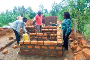 The Water Project: Eshisenye Girls Secondary School -  Director Catherine Checking Latrine Construction
