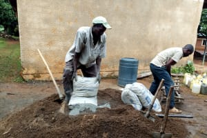 The Water Project: Namalasire Primary School -  Mixing Cement