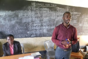 The Water Project: JM Rembe Primary School -  Wewasafo Staff Wagaka Erick Facilitating At The Training
