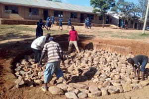 The Water Project: Kenneth Marende Primary School -  Laying Rocks For Tank Foundation