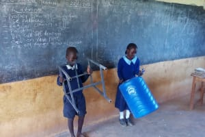 The Water Project: Kenneth Marende Primary School -  Students With Handwashing Tank
