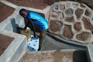 The Water Project: Chandolo Community, Joseph Ingara Spring -  Collecting Safe Water
