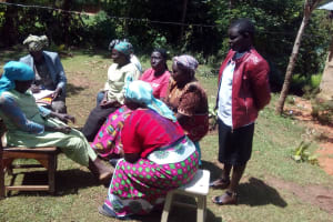 The Water Project: Wasenje Community, Margaret Jumba Spring -  Community Members Chat At Training